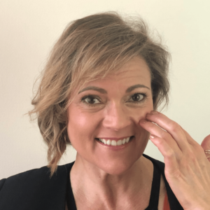 Sexologist demonstrating the cheekbone EFT tapping point